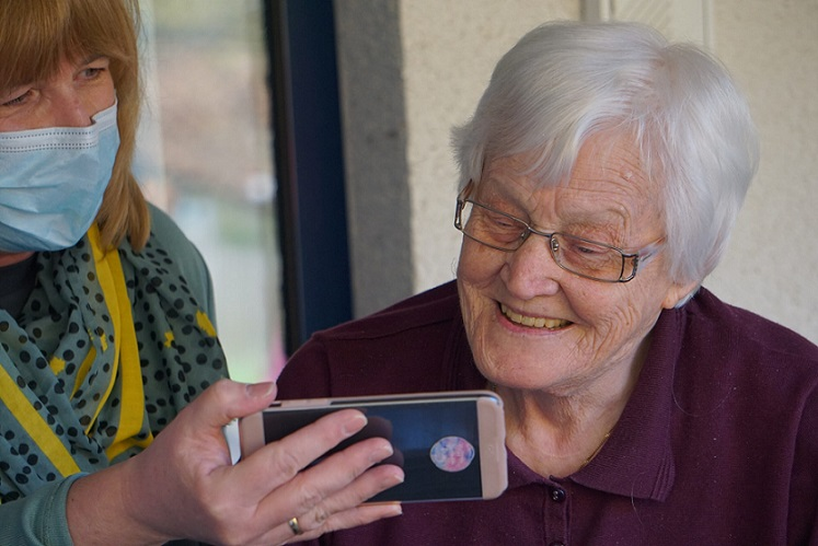 Elderly woman watching phone